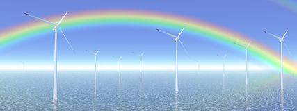 Rainbow and wind turbines Stock Photo
