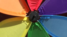 Rainbow windmill turning, 4K stock video footage