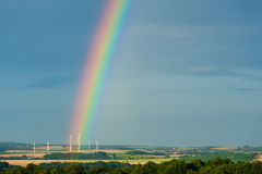 Rainbow and windmills Royalty Free Stock Images