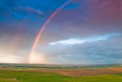 Free Rainbow With Rain Clouds And Blue Sky Royalty Free Stock Photography - 14535697