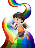A rainbow with a young woman running Royalty Free Stock Images