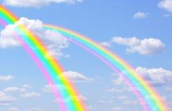 Rainbows. Beautiful bright rainbows in the blue sky Royalty Free Stock Photo