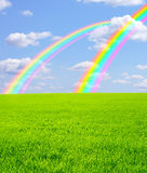Rainbows. Beautiful bright rainbows in the blue sky Royalty Free Stock Photos