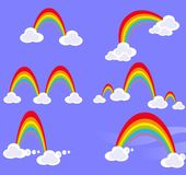 Set of rainbows with clouds on blue sky Royalty Free Stock Photo