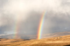 Rainbows Above The Wheat Field In Mountains Royalty Free Stock Photography