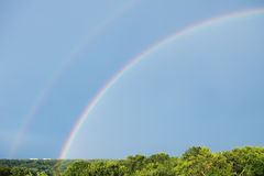 Rainbows in blue sky Royalty Free Stock Photography