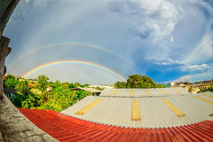 Rainbows on blue sky over the roof top Stock Photos