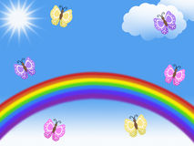 Rainbows and butterflies flying with clouds and sun and blank copy space Stock Photos