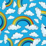 Rainbows and clouds on blue. Royalty Free Stock Images
