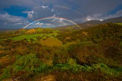 Rainbows. Double rainbows landscape in Cyprus durring winter time Royalty Free Stock Image