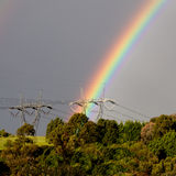 Rainbows and power lines Royalty Free Stock Photography