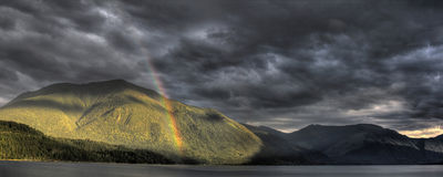 Rainbows, Storms, Good and Evil Stock Image