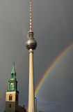 Rainbows, television tower and church Stock Images