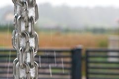 Rainchain during a storm. Rainchain or rain chain during a storm. Home exterior design. Unique plumbing solution. Whole series with sebczseries966 keyword stock photos