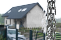 Rainchain during a storm. Rainchain or rain chain during a storm. Home exterior design. Unique plumbing solution. Whole series with sebczseries966 keyword royalty free stock images