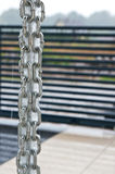 Rainchain during a storm. Rainchain or rain chain during a storm. Home exterior design. Unique plumbing solution. Whole series with sebczseries966 keyword royalty free stock image