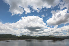 Raincloud moving on blue sky at mae kuang dam in doi saket district in chiangmai north of thailand Stock Photo