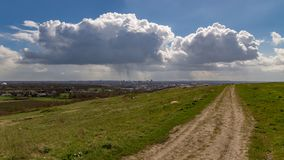 Raincloud over Dortmund, Germany. A raincloud over the skyline of Dortmund, Ruhr Area, North Rhine-Westfalia, seen from Deusenberg stock image