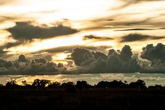 Rainclouds in the afternoon sunset. Large rainclouds rolling in during sunset Royalty Free Stock Photos