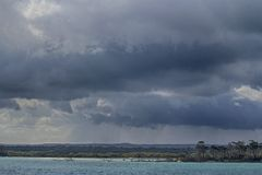 Rainclouds over Fraser Island. Rainclouds gather over Fraser Island Stock Photography