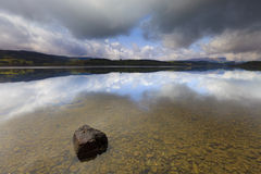 Rainclouds over a landscape in Scotland Stock Photography