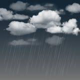 Rainclouds and rain in the dark sky Stock Image
