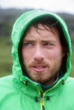 Raincoat - man outdoors in rain jacket Stock Photos