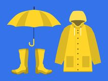 Raincoat, rubber boots, open umbrella, set of rainy season in flat on blue background design vector. Eps Royalty Free Stock Photography