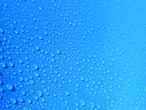 Raindrop on blue. Details of raindrops on blue background Royalty Free Stock Image