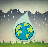 Raindrop on earth Royalty Free Stock Images
