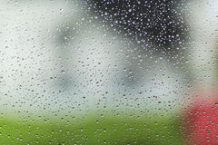 Raindrop patterns. On glass and colorful background Royalty Free Stock Photography