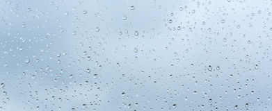 Raindrop patterns. On glass and colorful background Stock Photos