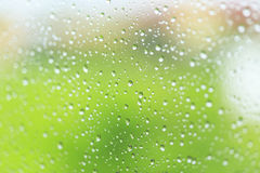 Raindrop patterns. On glass and colorful background Stock Photo