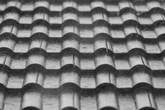Rain on the roof of a house. Raindrop on the roof of a house in black and white Royalty Free Stock Photos