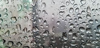 Raindrop on the transparent glass windows stock images
