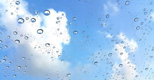 Raindrop on window with blue sky background Stock Photography