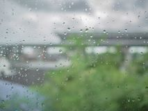 Raindrop on the window with blur photo of tree royalty free stock images
