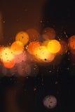 Raindrop on window with bokeh lighs. Drop of rain on window with city bokeh lighs Stock Photo