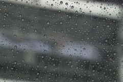 Raindrop at window car. On daytime that has blur background Royalty Free Stock Image
