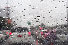Raindrop on windshield. In blocked traffic Royalty Free Stock Photo