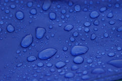 Raindrops. On the blue tent Stock Photos