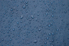 Raindrops. On the blue tent stock images