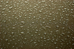 Raindrops. On metallic car paint royalty free stock image