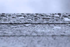 Raindrops. Rainy drops on stripeed surface Stock Photography