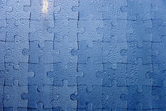 Raindrops as a jigsaw puzzle. Abstract blue background (raindrops on blue glass as a jigsaw puzzle Royalty Free Stock Photos