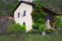 Raindrops on a background of the house Royalty Free Stock Photos