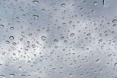 Raindrops beading on the sunroof on a rainy day. Raindrops beading on the sunroof window on a rainy overcast day Royalty Free Stock Photography