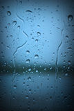 Raindrops on Blue Window Royalty Free Stock Photo