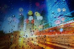 Raindrops on a blurred multicolored bokeh background royalty free illustration