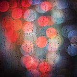 Raindrops and bokeh city lights background Royalty Free Stock Photos